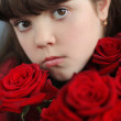 Portrait of attractive teen girl with red roses bouquet flowers — Stock Photo #21289657