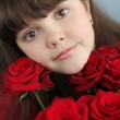 Portrait of attractive teen girl with red roses bouquet flowers — Stock Photo #21289663
