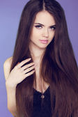 Beautiful woman with long brown hair. Closeup portrait of fashio — Stock Photo