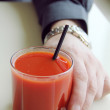 Royalty-Free Stock Photo: Men\'s hand holding Tomato juice