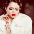 Fashion woman with red lips and nails in fur coat. Luxury and J — Stock Photo
