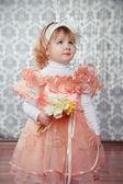 Portrait of funny lovely little girl at interior — Stock Photo