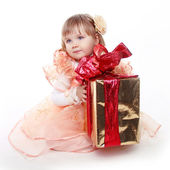 Little girl playing with gift box ribbon isolated on white backg — Stock Photo