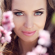 Постер, плакат: Stare Outdoors portrait of beautiful smiling woman model in pin