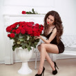 Royalty-Free Stock Photo: Sexy brunette woman with bouquet of red roses, bunch of flowers