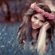 Young beautiful woman resting on grass over fairy tale park, Fai — Stock Photo