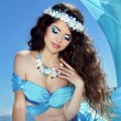 Stock Photo: Makeup. Sejewelry. Long Healthy Hair. Beautiful girl in blue s