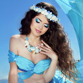 Makeup. Sea jewelry. Long Healthy Hair. Beautiful girl in blue s — Stock Photo