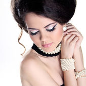 Closeup portrait of Beautiful woman with pearls and evening make — Stock Photo
