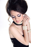 Beautiful Brunette Girl with hairstyle and make up isolated on w — Stock Photo