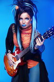 Rock girl posing with electric guitar playing hard-rock isolated — Stock Photo