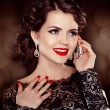 Young happy woman talking on mobile phone. Fashion Brunette Mode - ストック写真