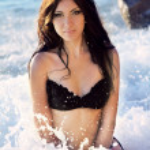 Sexy Brunette Woman in bikini on beach sea waves. Summer and sun — Stock Photo