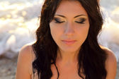 Summer portrait of beautiful woman face at sunset, ocean beach. — Stock Photo