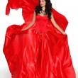 beautiful woman wearing in magnificent red dress isolated on whi — Stock Photo