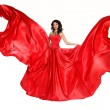 Beautiful woman in magnificent red dress isolated on white backg — Stock Photo