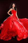 Beautiful woman in red dress isolated on black background. Studi — Stock Photo