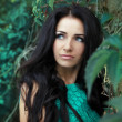 Beautiful woman with long black hair. Closeup portrait of brunet — Stock Photo