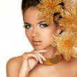 Beautiful Girl With Golden Flowers. Beauty Model Woman Face. Per — Stock Photo