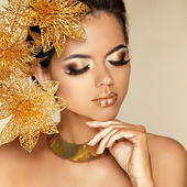 Eye Makeup. Beautiful Girl With Golden Flowers. Beauty Model Wom — Stock Photo