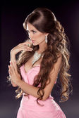 Hairstyle. Long wavy hair. Fashion photo of young woman. Sexy Gi — Stock Photo