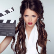 Fashion woman with sexy red lips holding cinema clap. Super star — Stock Photo
