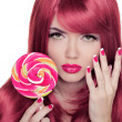 Beauty Girl Portrait holding lollipop with Colorful Makeup, Colo — Stock Photo #31725933