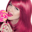 Happy smiling teen girl holding multicolored lollipop with pink — Stock Photo