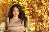 Beautiful girl with long hair enjoying the sunny in a autumn par — Stock Photo