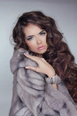 Beautiful brunette girl wearing in mink fur coat with long hair — Stock Photo