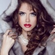 Fashion sexy model girl with red lips posing in Mink Fur Coat. W — Stock Photo