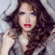 Fashion sexy model girl with red lips posing in Mink Fur Coat. W — Stok fotoğraf