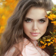 Autumn teen Girl Portrait. Beautiful young Woman over yellow lea — Stock Photo
