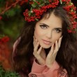 Autumn Girl Portrait. Beautiful young brunette Woman in red berr — Zdjęcie stockowe #33144733