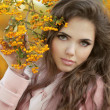 Beautiful  Autumn Girl Portrait. Young Woman posing over yellow  — Stock Photo