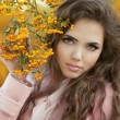 Beautiful Autumn Girl Portrait. Young Woman posing over yellow — Stock Photo #33144769