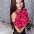 Amazing young beautiful happy smiling girl with pink bouquet of  — Stock Photo