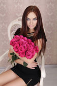 Portrait of young beautiful girl with pink roses flowers. Fashio — Stock Photo