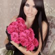 Beauty Fashion Brunette Portrait. Amazing girl holding bouquet o — Stock Photo