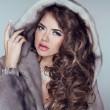 Beautiful brunette girl wearing in mink fur coat with long hair — Stock Photo
