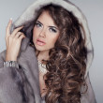 Long hair. Luxury beautiful wearing in mink fur coat with long — Stock Photo