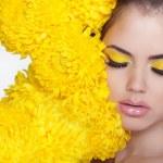 Beautiful Spa Woman over chrysanthemum flowers. Eyes makeup. Bea — Stock Photo #36086459
