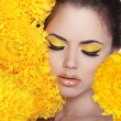 Beauty Portrait. Beautiful Spa Woman over yellow flowers. Eyes.  — Stock Photo