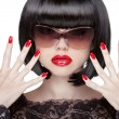 Fashion portrait of brunette woman in sunglasses showing red man — Stock Photo