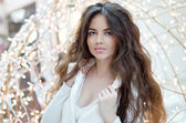 Portrait of beautiful brunette woman in fashionable clothes posi — Stock Photo