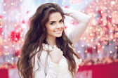 Christmas happy smiling teen girl over Xmas background. Young wo — Stock Photo