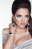 Beautiful woman with jewelry fashion accessories. Make-up. Beaut — Stock Photo