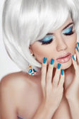 Manicured nails. Professional makeup. Blond woman Portrait. Whit — Stock Photo
