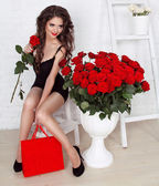 Beautiful fashion smiling girl with bouquet of roses and box gif — Stock Photo