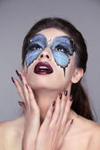 Face art portrait. Fashion model woman with painting butterfly o — Stock Photo